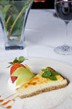 Cheesecake a la carte with roses and wine Royalty Free Stock Images