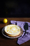 Cheesecake with lemon and zest, sour cream on top Royalty Free Stock Images