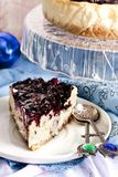 Cheesecake with mascarpone and blueberry sauce. Creamy cheesecake with mascarpone and blueberry sauce Stock Image