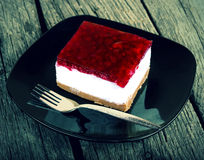Cheesecake on old wood table vintage photo Stock Photos