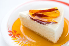 Cheesecake with peach Stock Photos