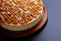 Cheesecake with peanuts Stock Images