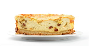 Cheesecake. A picture of cheesecake with rasins on a plate Royalty Free Stock Photography