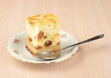 Cheesecake. A picture of cheesecake with rasins on a saucer Royalty Free Stock Photography