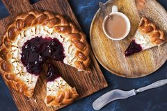 Cheesecake. Pie with cottage cheese and cherry jam. Stock Photos