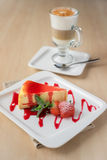 Cheesecake piece with strawberry sauce and berry Royalty Free Stock Photography