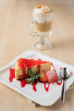 Cheesecake piece with strawberry sauce and berry Stock Photos