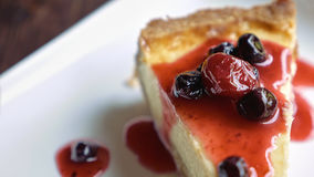 Cheesecake piece topped with fruit sauce Royalty Free Stock Photo