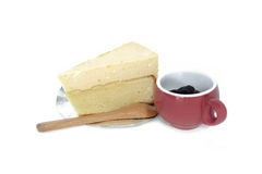 Cheesecake on a plate and blueberry sauce in cup Stock Photos