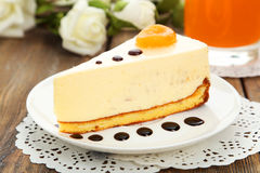 Cheesecake on the plate on brown wooden background Stock Photo