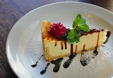 Cheesecake on a plate. Closeup royalty free stock images