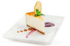 Cheesecake on the plate on white background Stock Photos