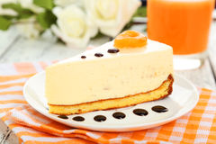 Cheesecake on the plate on white wooden background Royalty Free Stock Image
