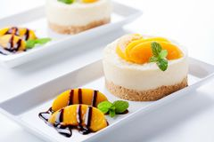Cheesecake With Poached Peaches And Chocolate Stock Photo