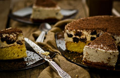 Cheesecake with prunes and chocolate cut on pieces Royalty Free Stock Photography