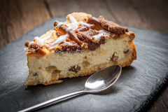 Cheesecake with raisins on a slate plate. Stock Photography
