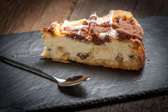 Cheesecake with raisins on a slate plate. Royalty Free Stock Images
