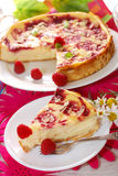 Cheesecake with raspberries and almonds. Piece of cheesecake with rasperries and almond flakes on party table Royalty Free Stock Photos