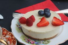 Cheesecake with raspberries, blueberries and strawberries stock image