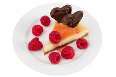 Cheesecake with raspberries and chocolate hearts Royalty Free Stock Photos