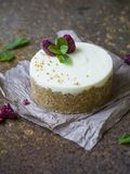 Cheesecake with raspberries and mint on a rusty metal background. Selective focus, copy space. Close up stock photo