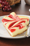 Cheesecake with raspberry swirls Stock Photos