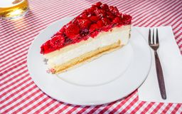 Cheesecake with raspberry topping Royalty Free Stock Image