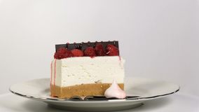 Cheesecake rotates on the turntable on a white background. Seamless loopable stock video footage
