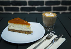 Cheesecake served with coffee. On the table stock photo