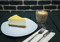 Cheesecake served with coffee. On the table royalty free stock photography
