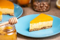 Cheesecake slice on a blue plate stock photo