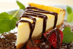 Cheesecake slice. With chocolate and strawberry Stock Images