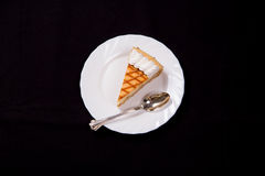 Cheesecake slice. Delicious cheesecake slice on black background Stock Photo