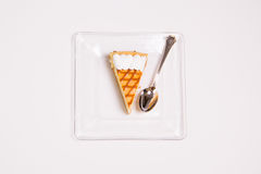 Cheesecake slice. Delicious cheesecake slice on white background Royalty Free Stock Photo