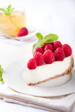 Cheesecake slice with fresh raspberry. And mint leaves Stock Image