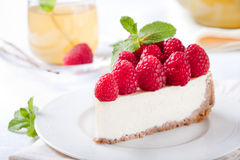 Cheesecake slice with fresh raspberry. And mint leaves Stock Images
