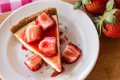 Cheesecake Slice With Fresh Strawberries From Above Stock Images