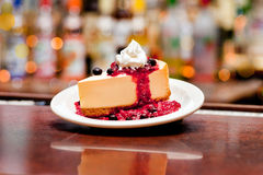 Cheesecake. A slice of cheesecake with whipped cream and raspberry sauce Royalty Free Stock Photography