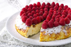Cheesecake, souffle, cream mousse, pudding dessert with fresh raspberries and mint leaves on a white plate.  Royalty Free Stock Photo