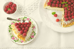 Cheesecake, souffle, cream mousse, pudding dessert with fresh raspberries and mint leaves on a white plate. Toned Royalty Free Stock Photos