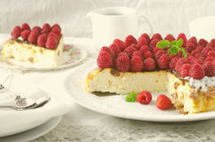 Cheesecake, souffle, cream mousse, pudding dessert with fresh raspberries and mint leaves on a white plate. Toned Royalty Free Stock Photography