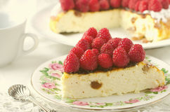 Cheesecake, souffle, cream mousse, pudding dessert with fresh raspberries and mint leaves on a white plate. Toned Royalty Free Stock Images
