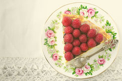 Cheesecake, souffle, cream mousse, pudding dessert with fresh raspberries and mint leaves on a white plate. Toned Stock Photos