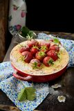 Cheesecake with strawberries in a bowl Royalty Free Stock Photo