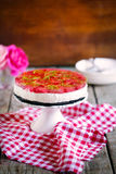 Cheesecake with strawberries and dark chocolate cookie crust Royalty Free Stock Photography