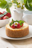 Cheesecake with strawberries on a plate Stock Photo
