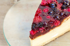 Cheesecake. With strawberries in a plate on a wooden table Stock Photo