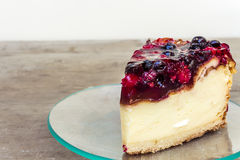 Cheesecake. With strawberries in a plate on a wooden table Stock Image