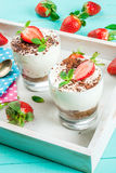 Cheesecake with strawberry and mint royalty free stock photo