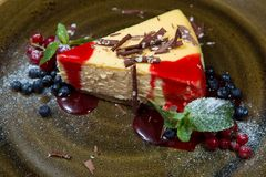 Cheesecake with strawberry sauce Royalty Free Stock Image